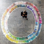 A person surrounded by color chips.